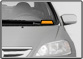 grayscale image of the front of a car with an orange rectangle highlighted in orange.